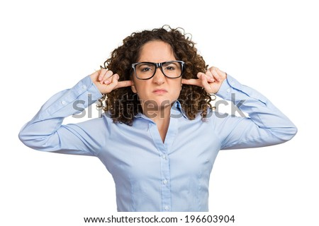 Closeup portrait unhappy, annoyed woman plugging closing ears with fingers, disgusted ignoring someone something not wanting to hear their side story, isolated white background. Human emotion reaction - stock photo