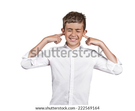 Closeup portrait unhappy annoyed young man plugging closing ears with fingers disgusted ignoring something not wanting to hear someone side story isolated white background. Human emotion body language - stock photo