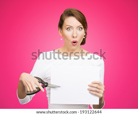 Closeup portrait, unhappy, confused, surprised, shocked business woman, funny looking female, worker employee cutting blank white paper, copy space, scissors isolated pink background. Face expression - stock photo