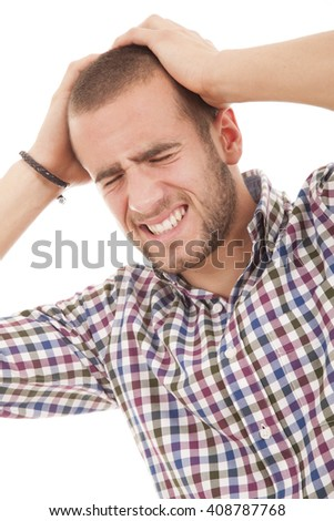 Closeup portrait, upset, frustrated, overwhelmed, stressed young man squeezing his head, going nuts, screaming, losing mind, isolated white background