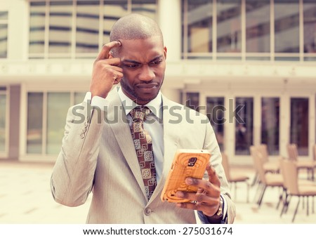 Closeup portrait upset sad skeptical unhappy serious man talking texting on phone displeased with conversation isolated outside city background. Negative human emotion face expression feeling - stock photo