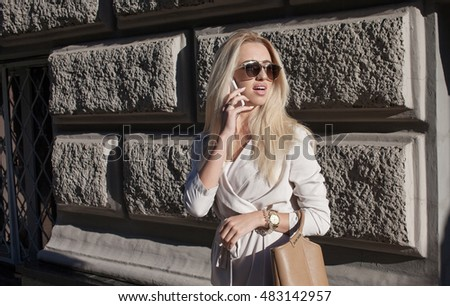 Closeup portrait upset sad skeptical unhappy serious woman talking on phone. Negative human emotion face expression feeling life reaction. Bad news