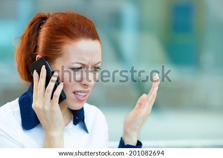 Closeup portrait upset sad, skeptical, unhappy, serious woman talking on phone, walking in hallway isolated office background. Negative human emotion facial expression feeling, life reaction. Bad news - stock photo