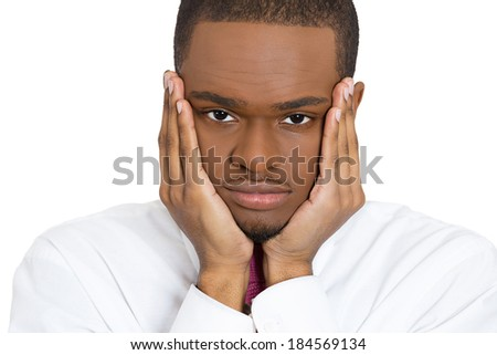 Closeup portrait, very sad depressed, stressed, alone, disappointed gloomy young man resting his head on hands, having suicidal thoughts, isolated white background. Human emotion facial expression