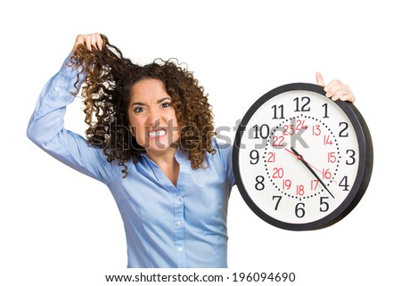 Closeup portrait woman, worker, holding clock looking anxiously, pressured by lack, running out of time isolated white background. Human face expression, emotion, reaction, corporate life. Last moment - stock photo