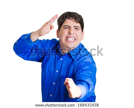 Closeup portrait, young angry, man raising hands in the air attack with karate chop, isolated white background. Negative human emotion facial expression feelings, body language, sign, symbols