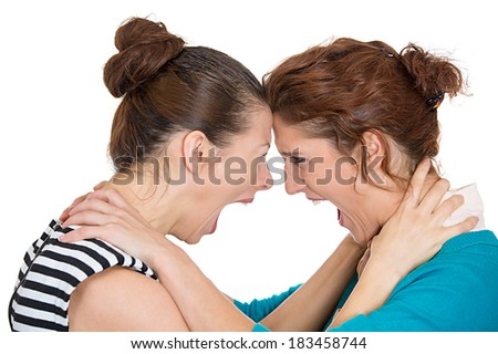 Closeup portrait young angry women, screaming, choking each other, blaming for problem, mistakes, isolated white background. Friendship difficulties concept negative emotion expression feeling - stock photo