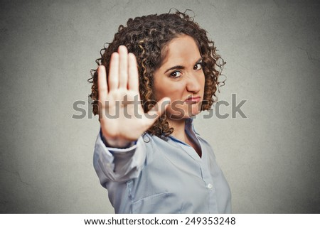 Closeup portrait young annoyed angry woman with bad attitude giving talk to hand gesture with palm outward isolated grey wall background. Negative human emotion face expression feeling body language - stock photo