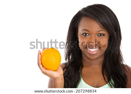 Closeup portrait young beautiful, laughing, healthy woman holding orange, excited about new diet isolated white background. Human facial expressions, emotion, life perception. Smart, good food choices - stock photo