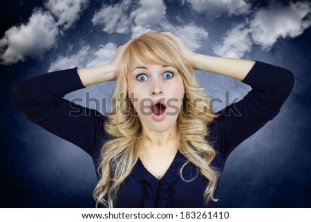 Closeup portrait, young, beautiful woman, looking excited, surprised in full disbelief, hands on head, isolated blue-gray background with white clouds. Emotions, facial expression, reaction, attitude - stock photo