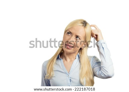 Closeup portrait young blonde woman scratching head thinking daydreaming deeply about something looking up isolated white background. Human facial expression emotion feeling sign symbol body language - stock photo