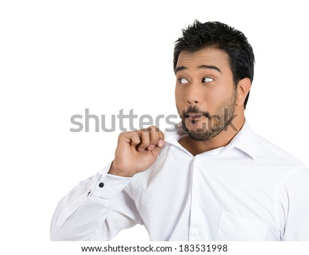 Closeup portrait, young business man opening shirt to vent, it's hot, unpleasant, awkward situation, embarrassment. Isolated white background. Negative human emotions, facial expression, feelings - stock photo