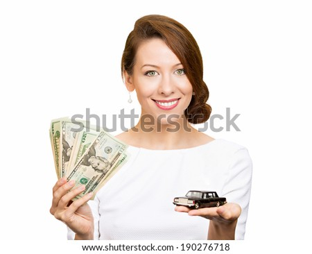 Closeup portrait, young business woman, bank agent, representative holding model black car, green dollar cash bills in hand, isolated white background.Lease offers, credit line, financing, dealership - stock photo