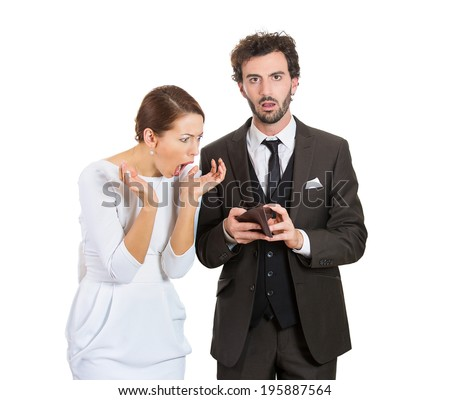 Closeup portrait young couple woman, man showing holding empty wallet, no money being broke, over budget, poor, looking surprised, isolated white background. Negative facial expression emotion feeling - stock photo
