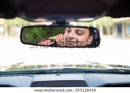 Closeup portrait, young guy drinking alcoholic beverage stoned, under the influence,  isolated interior car windshield background. A menace driver to the road  - stock photo