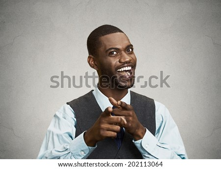 Closeup portrait, young handsome business man with two hands guns sign gesture pointing at you camera, isolated black grey background. Positive human emotion facial expression feelings, signs, symbols - stock photo