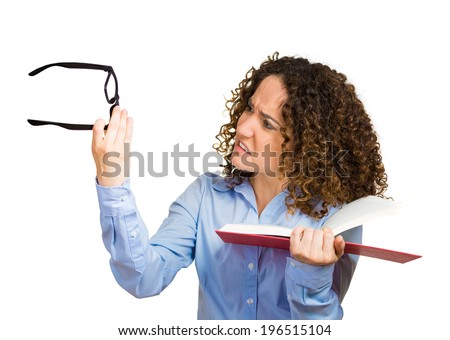 Closeup portrait young lady, woman can't see read book, has vision problems, wrong glasses prescribed upset isolated white background. Human emotion, facial expression, feeling, health issue, reaction - stock photo