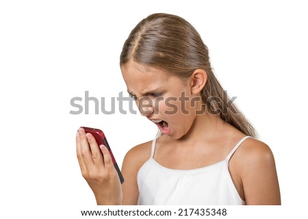Closeup portrait young mad, frustrated angry teenager girl yelling while on phone isolated white background. Negative human emotion facial expression feelings. Communication, conflict resolution - stock photo