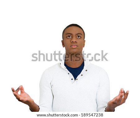 Closeup portrait, young man, eyes open, looking up, in meditation zen mode, isolated white background. Stress relief techniques concept. Positive human emotions, facial expression sign, feelings