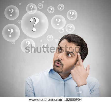 Closeup portrait young man thinking daydreaming deeply about something finger on head looking away up isolated grey background. Negative emotion facial expression feeling reaction situation perception