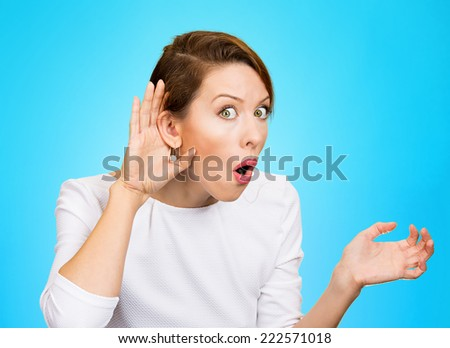 Closeup portrait young nosy woman hand to ear gesture trying carefully intently secretly listen in on juicy gossip conversation news privacy violation isolated blue background. Human face expression - stock photo