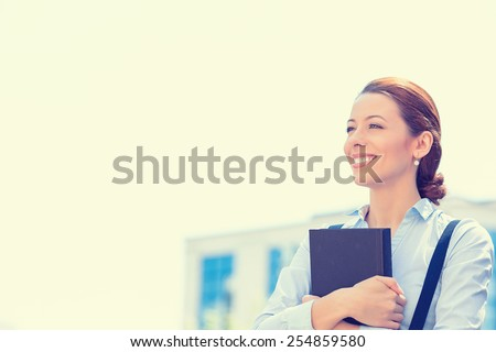 Closeup portrait, young professional, beautiful confident businesswoman in blue shirt smiling isolated outdoor city background. Positive human emotions, facial expressions, life perception - stock photo