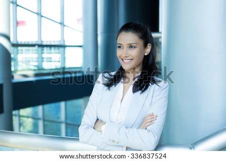 Closeup portrait, young professional, beautiful confident woman in pink shirt gray suit, arms crossed folded, smiling isolated indoors office background. Positive human emotions - stock photo
