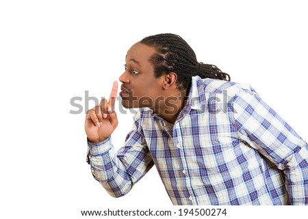 Closeup portrait young serious man placing finger on lips to say, shh, be quiet, silence, isolated white background.  - stock photo