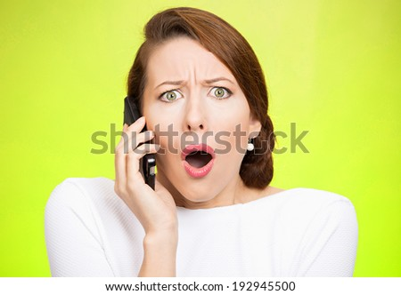 Closeup portrait young shocked business woman, corporate employee talking on cell phone, having unpleasant, bad conversation, isolated green background. Negative emotions, facial expressions, reaction - stock photo