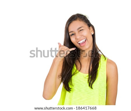 Closeup portrait, young single, flirty wink woman, happy student, worker making call me gesture, sign with hand shaped like phone, isolated white background. Positive human emotions, face expressions - stock photo