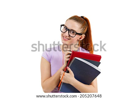 Closeup portrait young smart  woman with glasses, holding books, listening to music, prepared, ready to take her test finals, isolated white background. Positive facial expressions, feelings, emotions - stock photo
