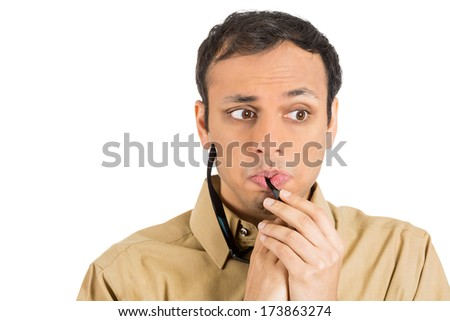 Closeup portrait young stressed man, anxious student, upset worker, nervous teacher, glasses in mouth, looking completely lost, confused, isolated on white background. Negative emotions, expressions - stock photo