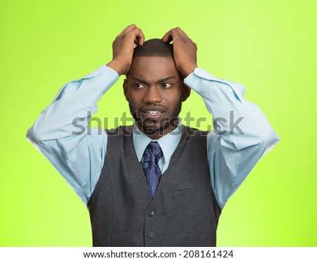 Closeup portrait, young, stressed, unhappy executive man with hands on temples, head about to explode, almost having nuclear meltdown, isolated green color background. Warhol style picture - stock photo