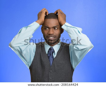 Closeup portrait, young, stressed, unhappy executive man with hands on temples, head about to explode, almost having nuclear meltdown, isolated blue color background. Warhol style picture - stock photo