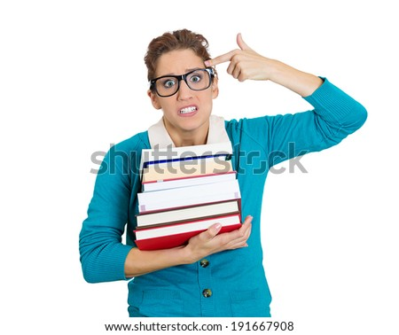 Closeup portrait young stressed woman, big glasses, holding books, anxious, ready to shoot herself, anticipation finals exam test, isolated white background. Negative facial expression feeling emotion - stock photo