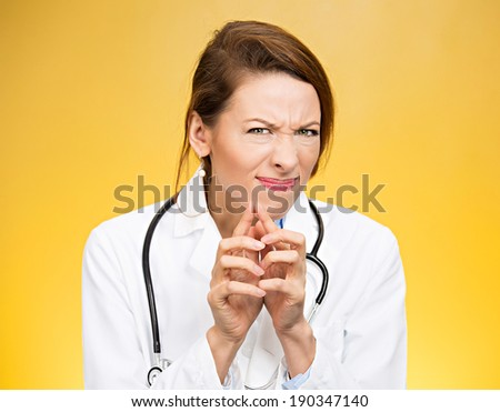 Closeup portrait, young suspicious, skeptical crazy female doctor, psychiatrist looking funny, pessimistic, craving, anxious, isolated, yellow background. Human facial expressions, emotions, feelings - stock photo