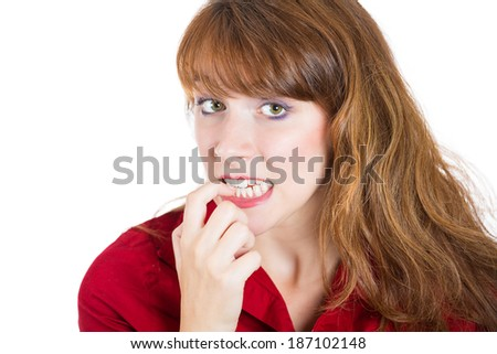 Closeup portrait, young, unsure, hesitant, nervous woman biting her fingernails craving for something anxious, isolated white background. Negative human emotions facial expressions feelings