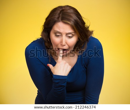 Closeup portrait young woman, annoyed, frustrated fed up sticking fingers in her throat showing she is about to throw up. Case anorexia nervosa, Isolated yellow background. Negative face expression - stock photo