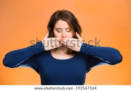 Closeup portrait young woman covering closed mouth, eyes. Speak, see no evil concept, isolated orange background. Negative human emotion, facial expression, signs, symbol, reaction. Media news coverup - stock photo
