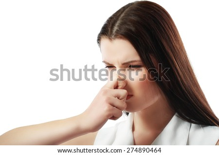 Closeup portrait young woman, disgust on face, pinches nose looks funny, something stinks, very bad smell, situation, isolated white background. Negative emotion, facial expression, feeling reaction - stock photo