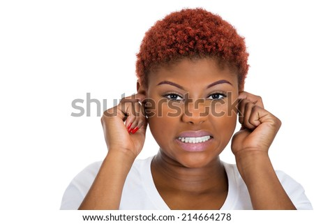 Closeup portrait young woman plugging her ears with fingers, looking frustrated, stop making that loud noise, giving me headache, isolated white background.  Negative human face expression, emotions - stock photo