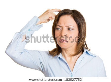 Closeup portrait young woman, scratching head, thinking, daydreaming deeply about something, looking up, isolated white background. Human facial expressions, emotions, feelings, signs, symbols.