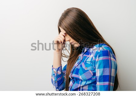 Closeup portrait young woman, scratching head, thinking, daydreaming deeply about something, looking up, isolated white background. Human facial expressions, emotions, feeling, sign, symbols, reaction - stock photo