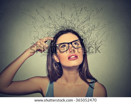 Closeup portrait young woman scratching head, thinking daydreaming with brain melting into lines question marks looking up isolated on gray background. Human facial expressions, emotion feeling sign - stock photo