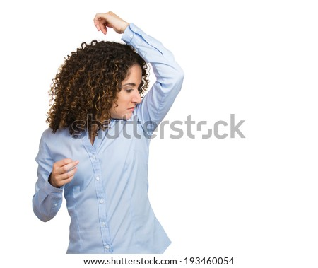 Closeup portrait young woman, smelling, sniffing her wet armpit, something stinks, very bad foul odor situation isolated white background. Negative human emotions, facial expressions, feeling reaction - stock photo