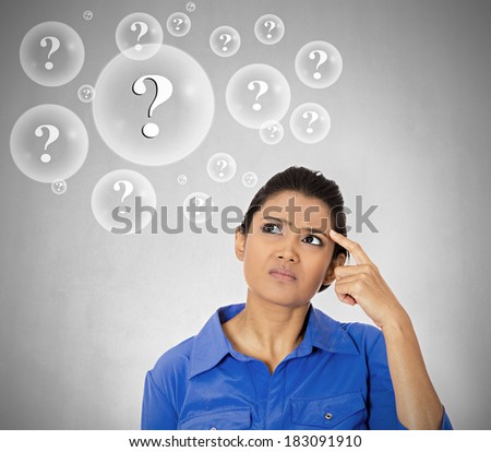 Closeup portrait young woman thinking, daydreaming deeply about something finger on temple looking up isolated grey background. Negative emotion facial expression feeling reaction situation perception - stock photo