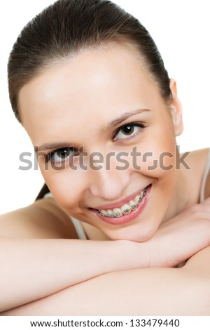 Closeup portrait young woman with brackets on teeth - stock photo