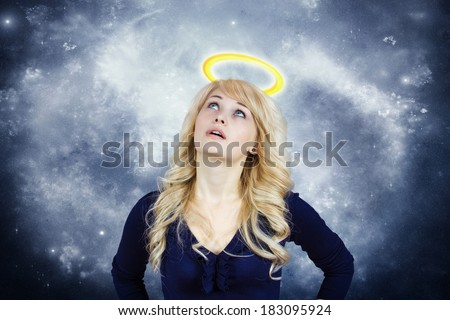 Closeup portrait young woman with halo, praying, dreaming, thinking, wishing, hoping, asking, begs for best in life isolated gray-white space background. Emotion, facial expression, feelings, attitude - stock photo