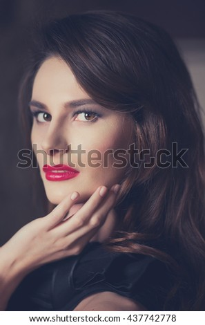 Closeup portraits of beautiful brunette model type with a professional evening makeup