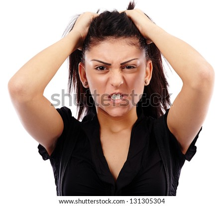 Closeup pose of an angry businesswoman pulling her her, isolated on white background - stock photo